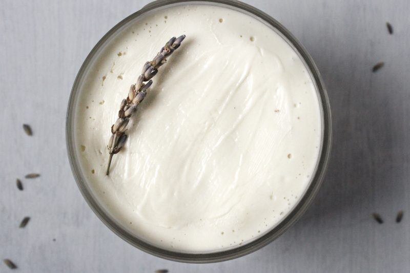magnesium body butter in a container with lavender on top