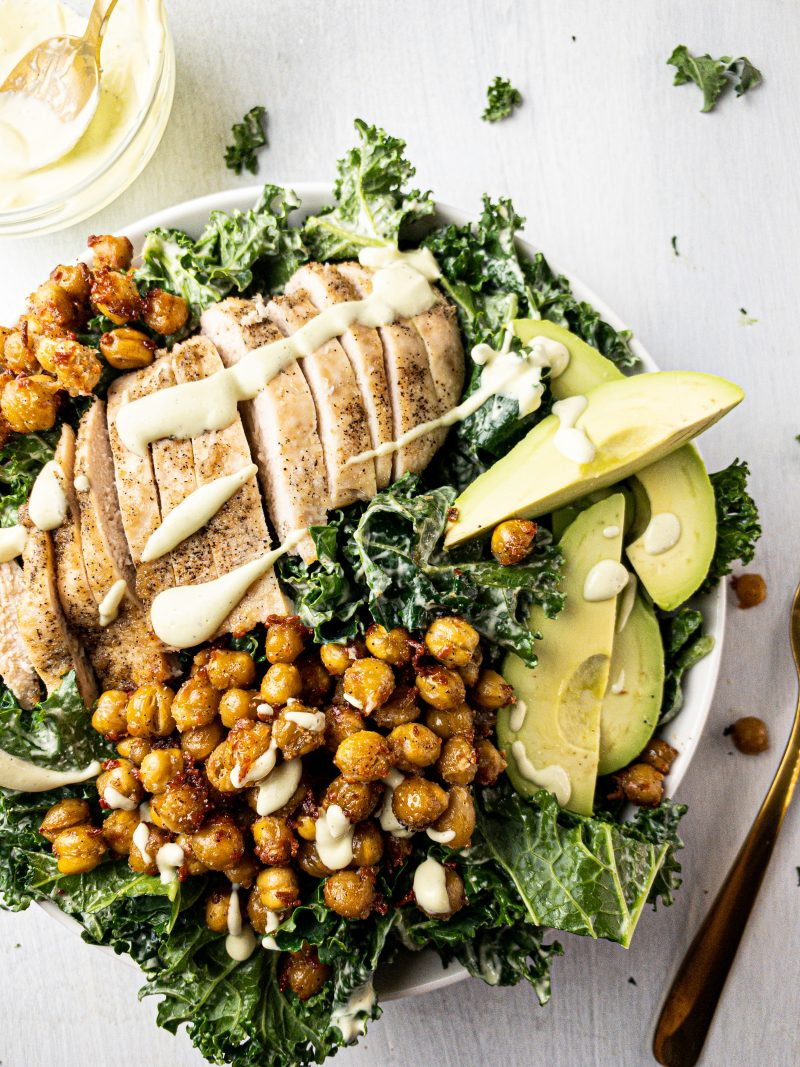 avocado chicken kale caesar salad with crispy roasted parmesan chickpeas