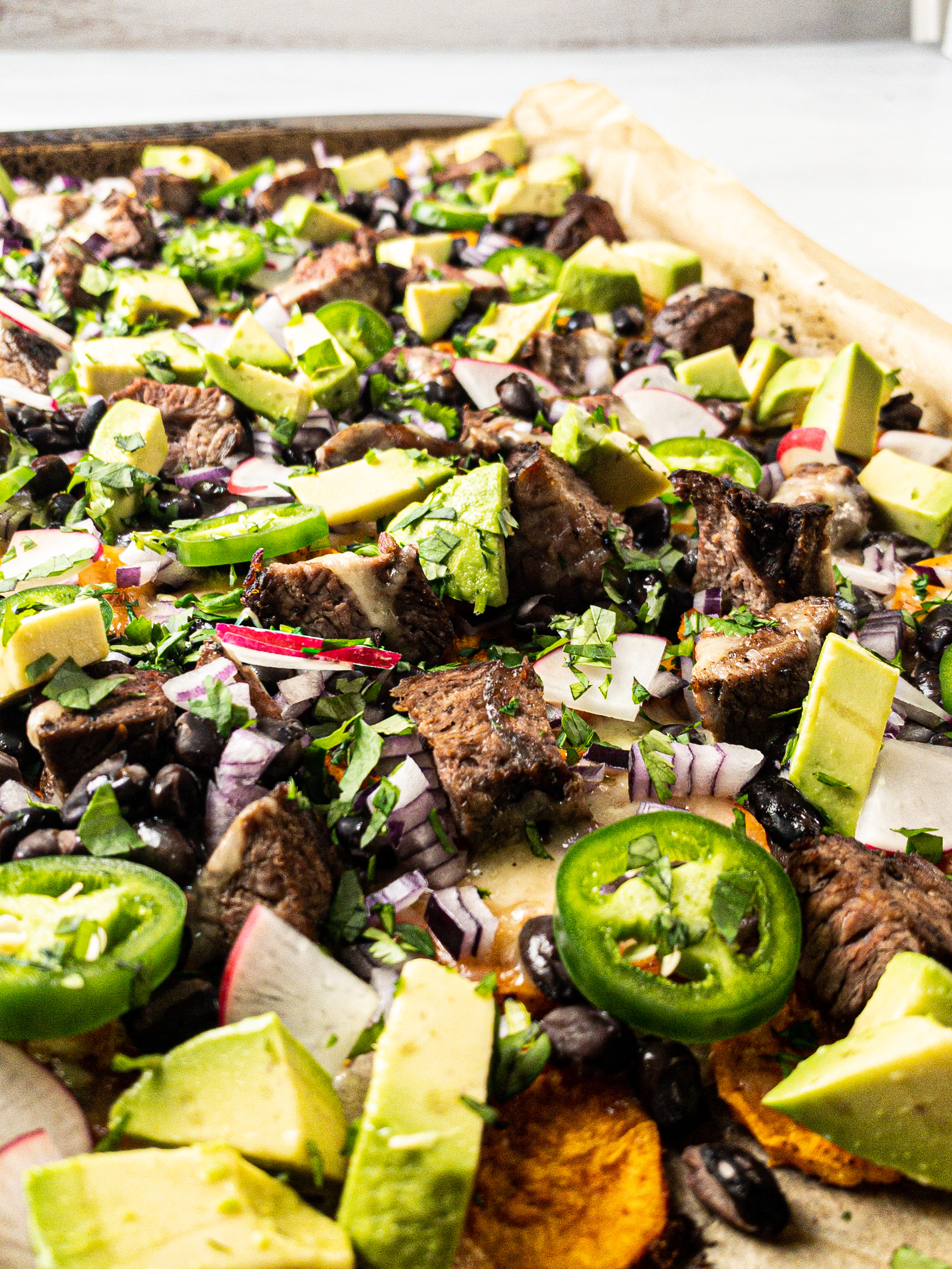 Loaded Sweet Potato Steak Sheet Pan Nachos with Black Beans and Avocado
