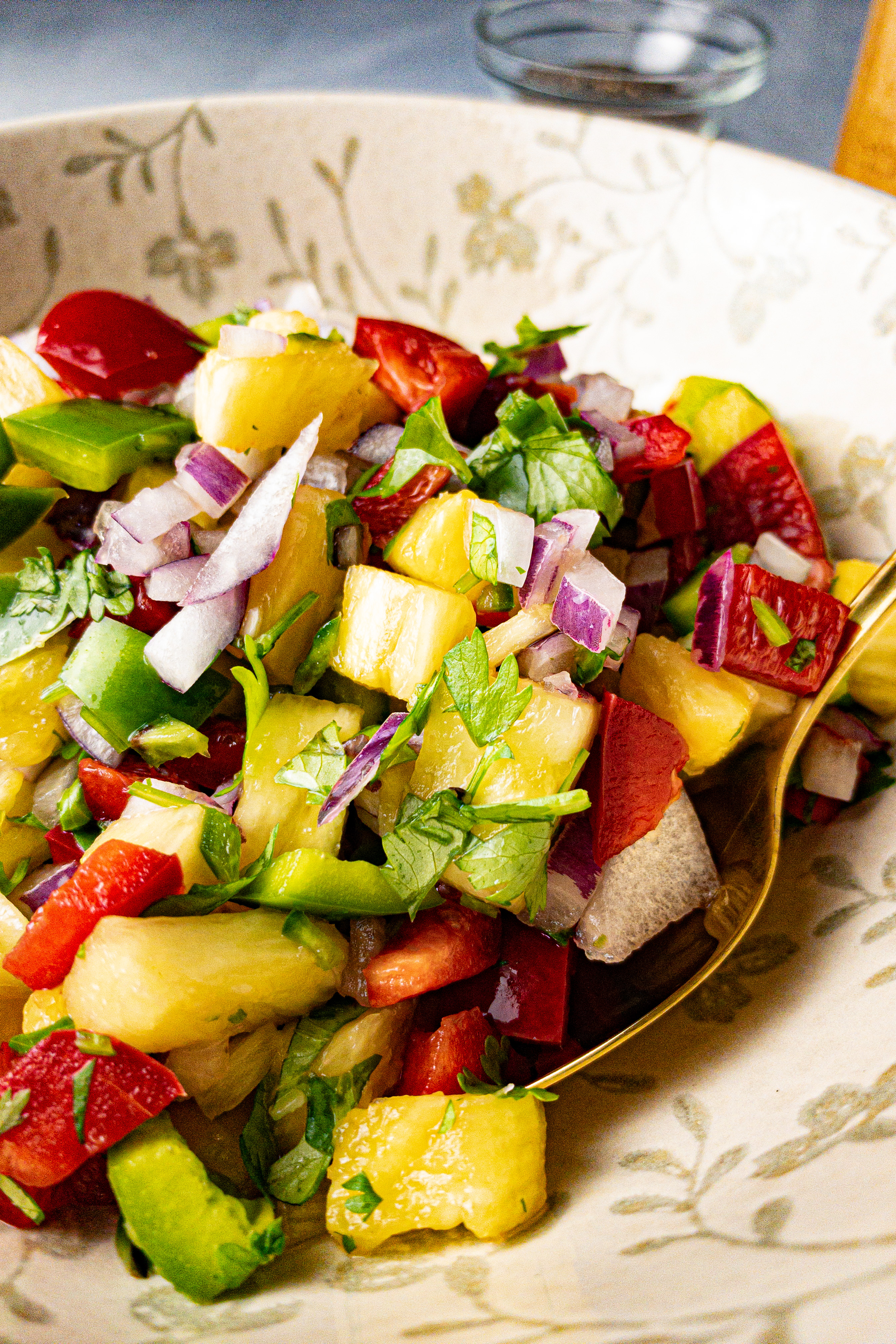 Healthy pineapple salsa with rainbow bell peppers